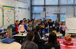 Teachers, parents, and students in a classroom