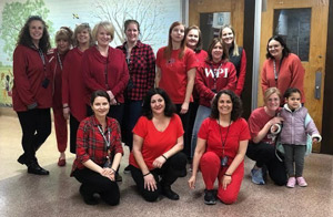 Adults wearing red clothing