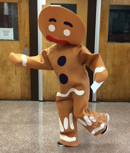 Person dressed up as a gingerbread man