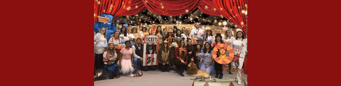Ridge Ranch staff members wearing carnival and circus themed Halloween costumes pose together