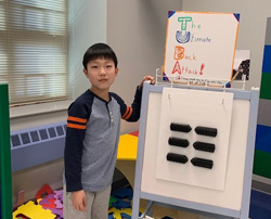 Male student with his invention