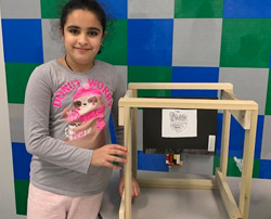 Female student with her invention