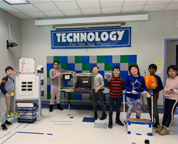 A class of students with their inventions
