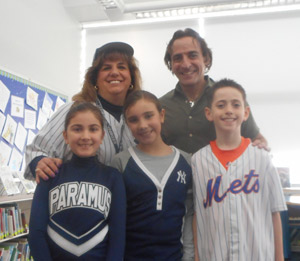 Author Phil Bildner sanding with a teacher and students