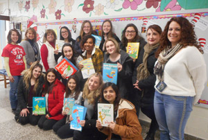 Group of students and teachers holding Dr. Seuss books
