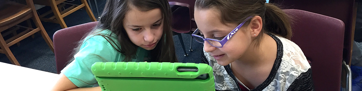 Students sharing a tablet