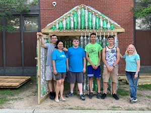 students in front of the green house