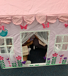 Students reading in a playhouse
