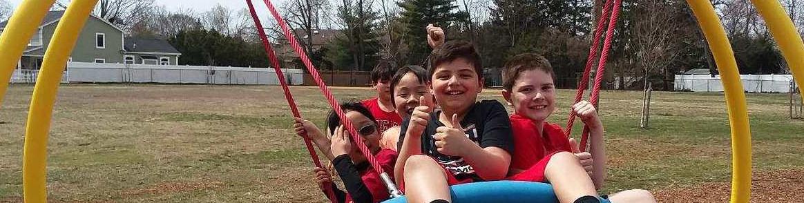 Kids on giant tire swing