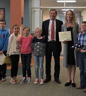 Senator John Barrasso proudly presented the National Blue Ribbon Award to Westside student council members, Principal Angela Woyak, & Superintendent Jay Curtis.
