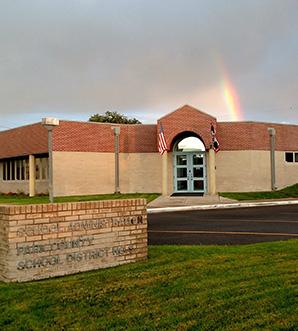 Rainbow over a school building