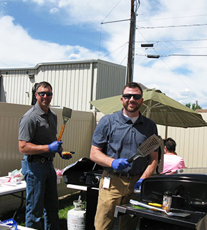 Superintendent grilling outside with a friend