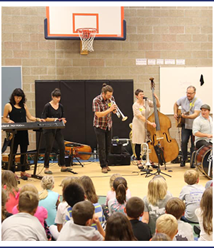 Students watch a band play in the gym