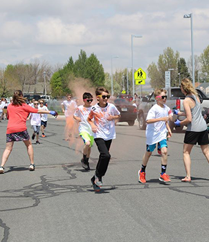 Students participating in an outdoor color run activity