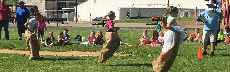 Students jump in potato sacks