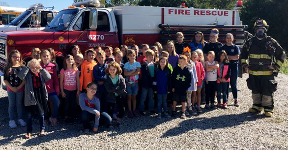 large group of students with firemen