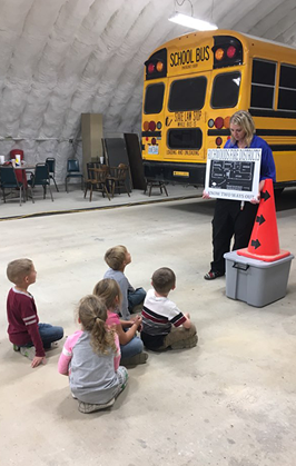 group of students learning about the bus