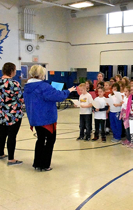 Teachers lead students in choir