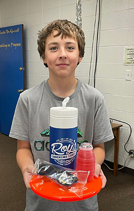 Student showing food items