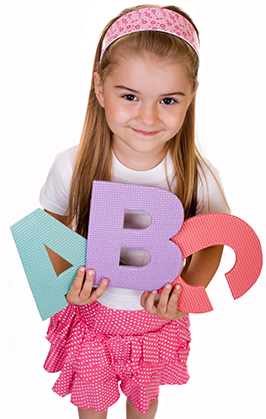 Female student holds ABC letters