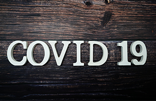 Wood letters that say COVID 19