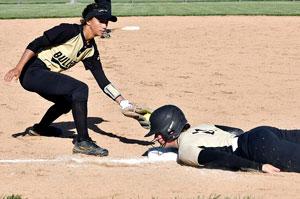 Madison-Grant's Makennah Clouse dives back to third base