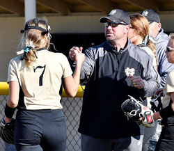 Madison-Grant's pitcher Elizabeth Lee gets a fist bump from head coach Travis Havens
