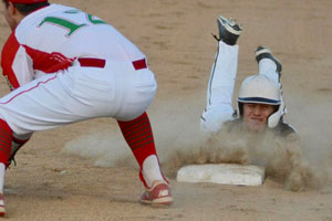 Madison-Grant's Chad Harbert dives safely into third base