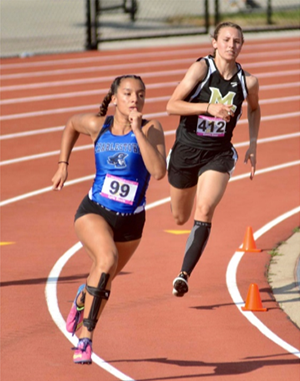 Madison-Grant junior Emma Ewer runs through the turn
