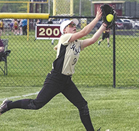 Madison-Grant's Chelsea Bowland runs to catch a ball hit in the right-field foul territory in 2019