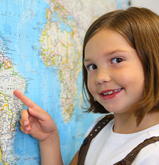 Female student points at a world map