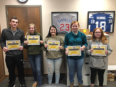 Students of the week pose with their certificates