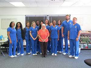 October 2019 Monroeville Licensed Practical Nursing Program graduates pose together with a staff member
