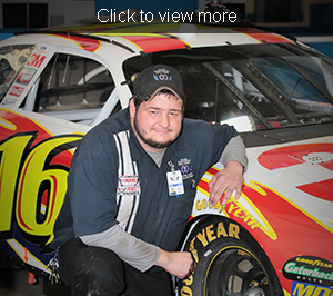 Jacob Eggie poses with a racing car