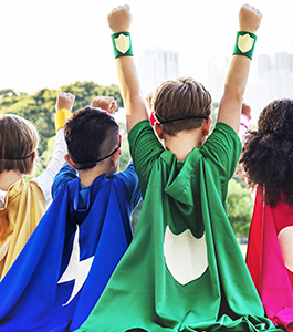 Back view of students dressed as superheroes