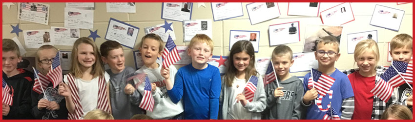 Students holding American flags