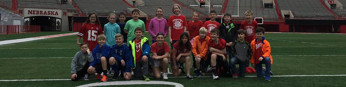 Group of students on Nebraska football field