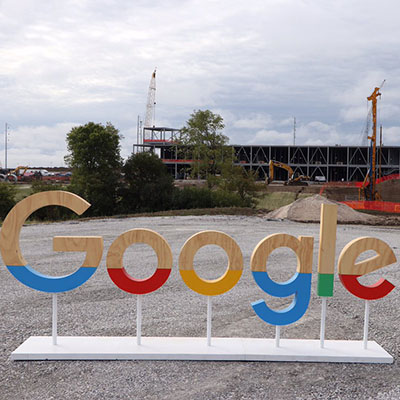 Google sign placed outside in front of construction