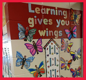 Learning Gives You Wings bulletin board with butterflies