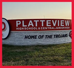 Trojans logo sign on a brick wall
