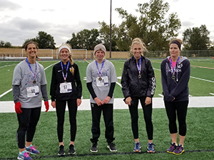 Five winners of the 5K pose together