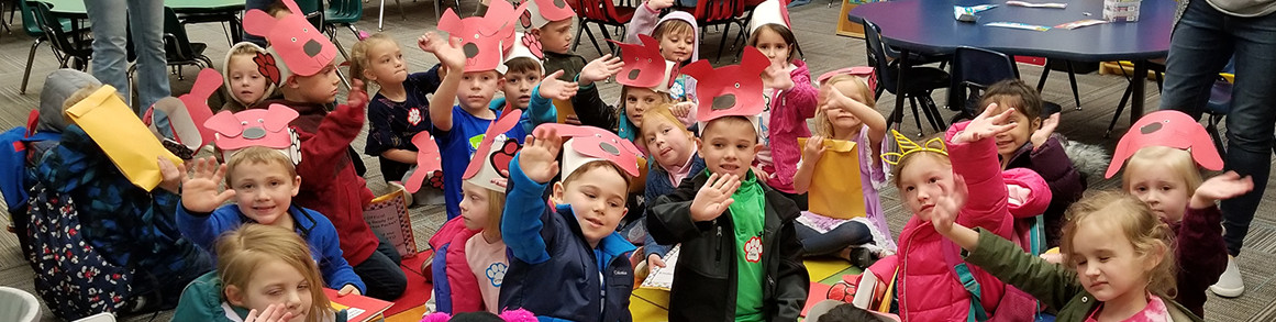 Students with clifford hats in classroom