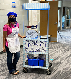 Our art teacher with her awesome art cart ready to teach students