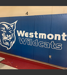 Westmont Wildcats banner hanging in the gym