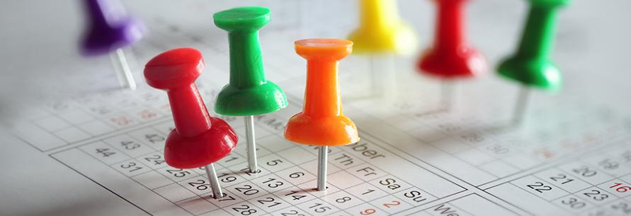 Thumbtacks stuck in calendar