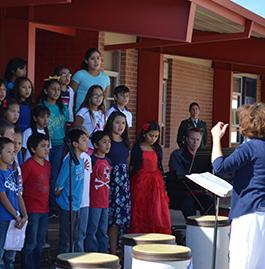 Woman leads children in choir