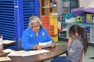 Grandparent helping a student with schoolwork