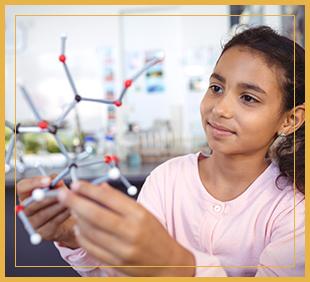 Female student holding a molecule model