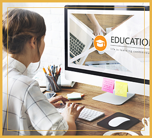 Woman uses a computer with the word education on the screen