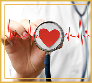 Doctor holding up a stethoscope with a paper heart in the center